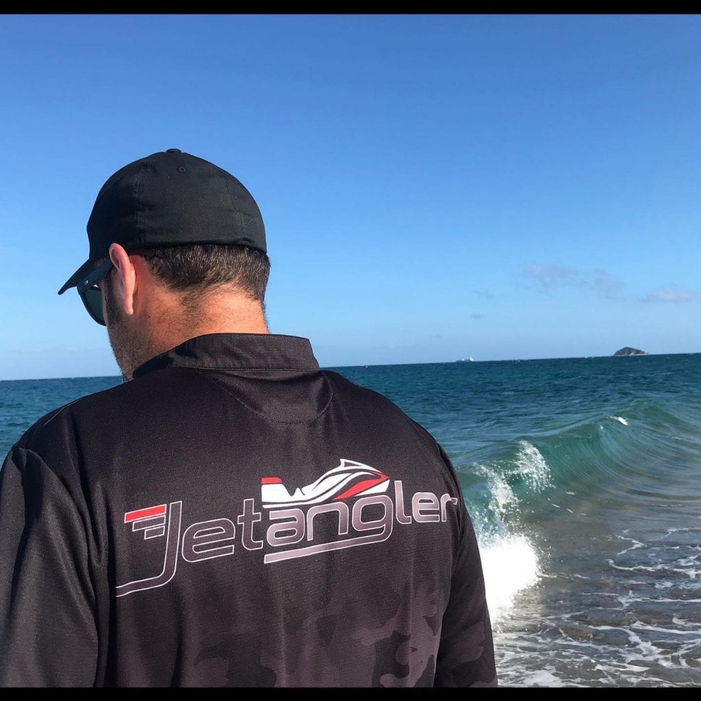 Jet Angler fishing shirts on shore entering beach